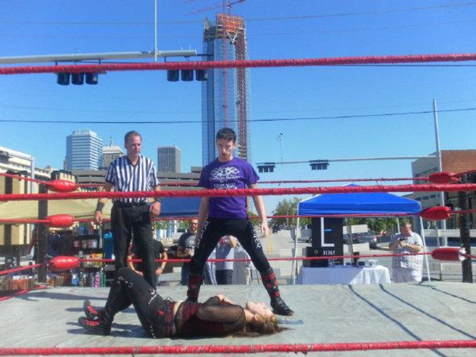 Photo - Dalton Bragg stands victorious over his female opponent Rose Thorn. This was one of many wrestling matches at the MANifesto arts festival. The festival was closed early due to lack of public interest.    Special to The Oklahoman - By Danniel Parker