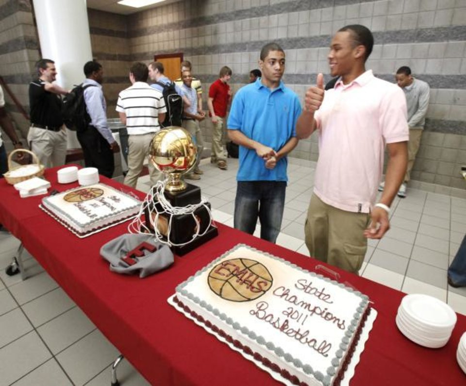 Jordan Woodward (front) gives a thumbs-up next to teamate Reggie Sloan, as the Edmond Memorial boys basketball team celebrates their State Championship during a ceremony at Edmond Memorial High School in Edmond, OK, Friday, March 25, 2011. By Paul Hellstern, The Oklahoman <strong>PAUL HELLSTERN</strong>