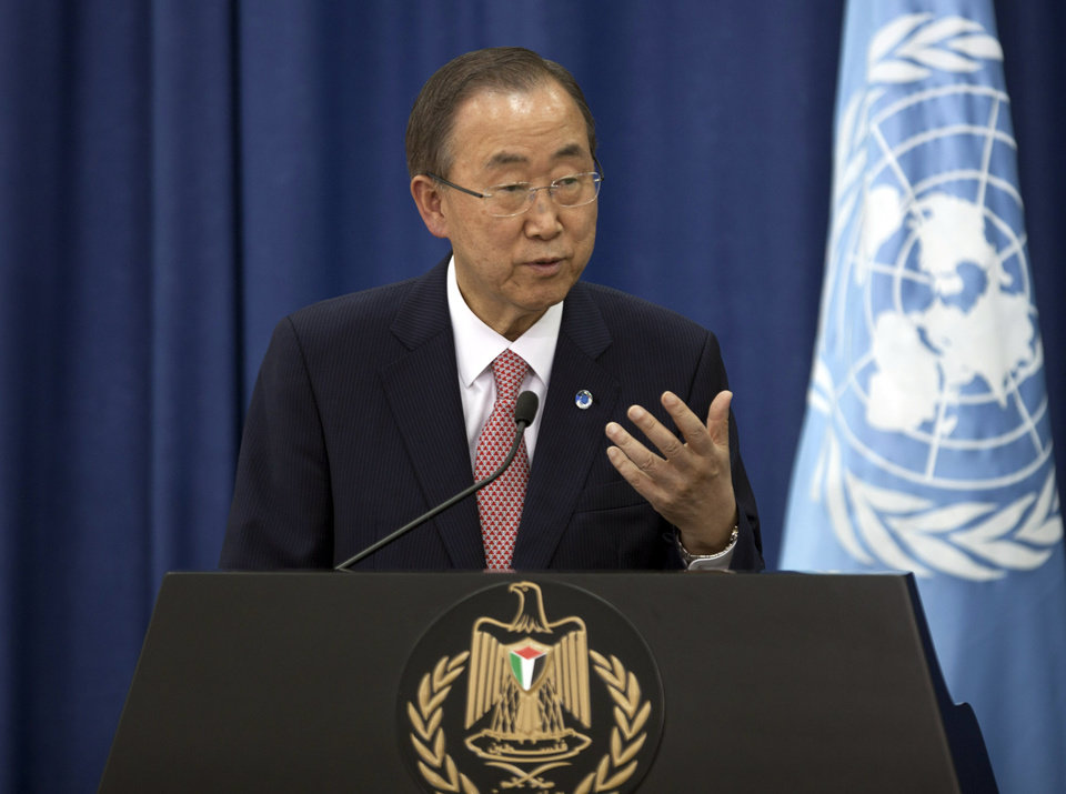 Photo - United Nations Secretary-General Ban Ki-moon speaks during a joint news conference with Palestinian Prime Minister Rami Hamdallah, in the West Bank city of Ramallah, Tuesday, July 22, 2014, regarding the Israel-Hamas conflict. (AP Photo/Majdi Mohammed)
