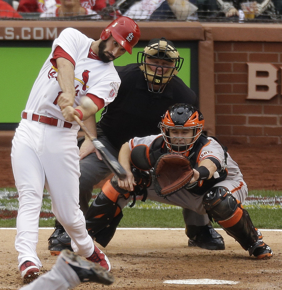 Photo -   St. Louis Cardinals' Matt Carpenter (13) hits a two-run home run during the third inning of Game 3 of baseball's National League championship series against the San Francisco Giants, Wednesday, Oct. 17, 2012, in St. Louis. (AP Photo/Mark Humphrey)