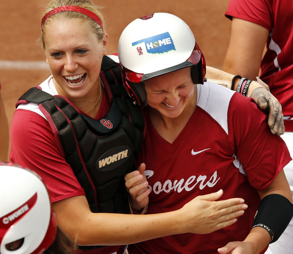 Jessica Shults, left, hugs Shelby Pendley after one of Pendley's home runs in the NCAA Super Regional softball game as the University of Oklahoma (OU) Sooners defeat Texas A&M 8-0 at Marita Hines Field on Saturday, May 25, 2013 in Norman, Okla. to advance to the College World Series.  Photo by Steve Sisney, The Oklahoman