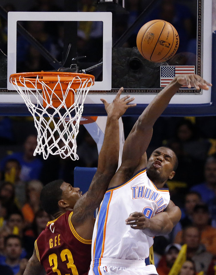 Oklahoma City's Serge Ibaka (9) blocks the shot of Cleveland's Alonzo Gee (33) during the NBA basketball game between the Oklahoma City Thunder and the Cleveland Cavaliers at the Chesapeake Energy Arena, Sunday, Nov. 11, 2012. Photo by Sarah Phipps, The Oklahoman