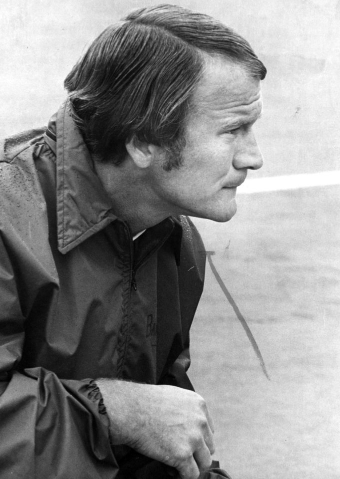 "Photo - FOOTBALL OU UNIVERSITY OF OKLAHOMA BARRY SWITZER B 1975 22.jpg: Caption reads ""OU coach Barry Switzer ponders the situation on the field during the game against Pittsburgh."" Photo by Al McLaughlin. Photo taken 9-12-1975. Photo published in The Daily Oklahoman 12-28-1975."
