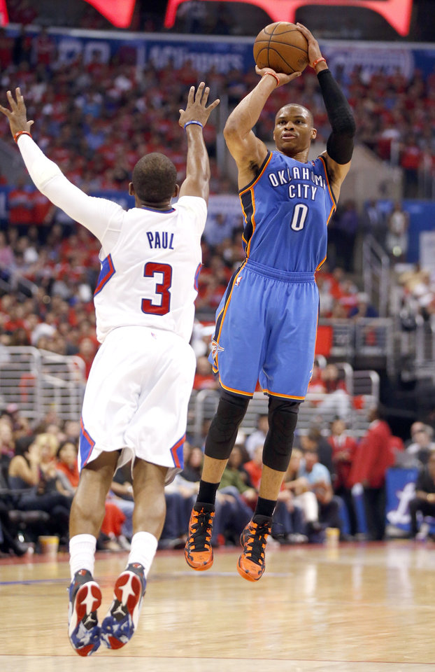 Photo - Oklahoma City's Russell Westbrook (0) shoots over Los Angeles' Chris Paul (3) during Game 3 of the Western Conference semifinals in the NBA playoffs between the Oklahoma City Thunder and the Los Angeles Clippers at the Staples Center in Los Angeles, Friday, May 9, 2014. Photo by Nate Billings, The Oklahoman
