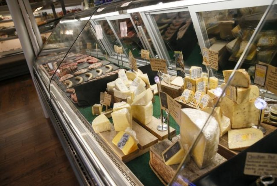 Photo -  The cheese and meat case at Urban Agrarian, 1 E Main St., in Edmond. [Nate Billings/The Oklahoman]