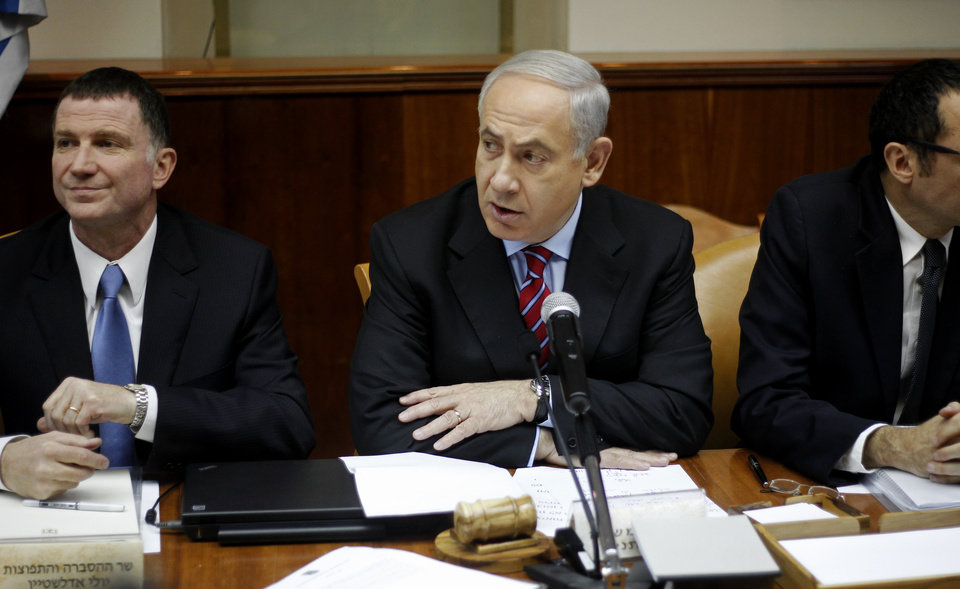 Israeli Prime Minister Benjamin Netanyahu, center, heads the weekly Cabinet meeting at his Jerusalem office, Sunday, Jan. 27, 2013. Sitting left is Cabinet minister Yuli Edelstein. (AP Photo/Ariel Schalit)