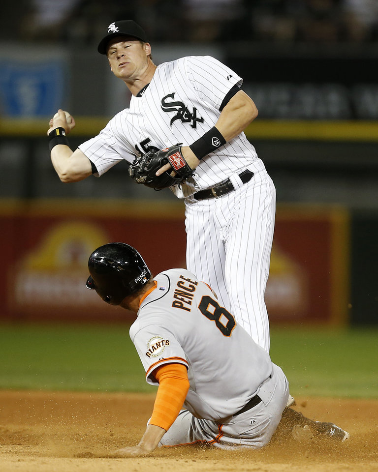 Photo - Chicago White Sox second baseman Gordon Beckham forces out San Francisco Giants' Hunter Pence on a double play during the seventh inning of a baseball game on Tuesday, June 17, 2014, in Chicago. (AP Photo/Andrew A. Nelles)