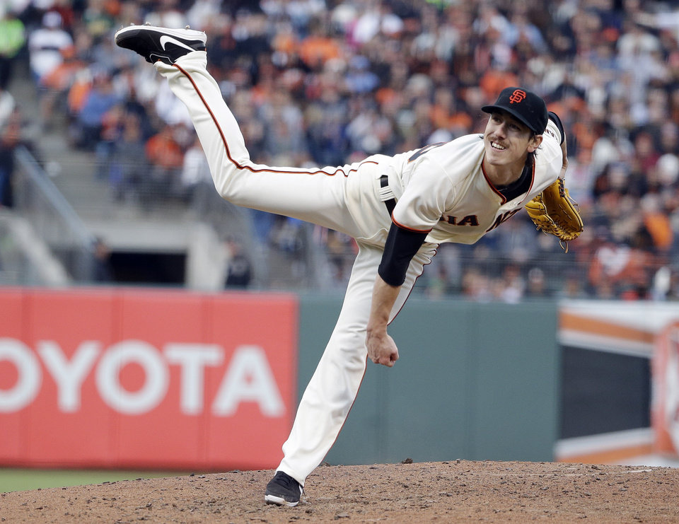 Photo - San Francisco Giants starting pitcher Tim Lincecum throws to the Miami Marlins during the fourth inning of a baseball game on Saturday, May 17, 2014, in San Francisco. (AP Photo/Marcio Jose Sanchez)
