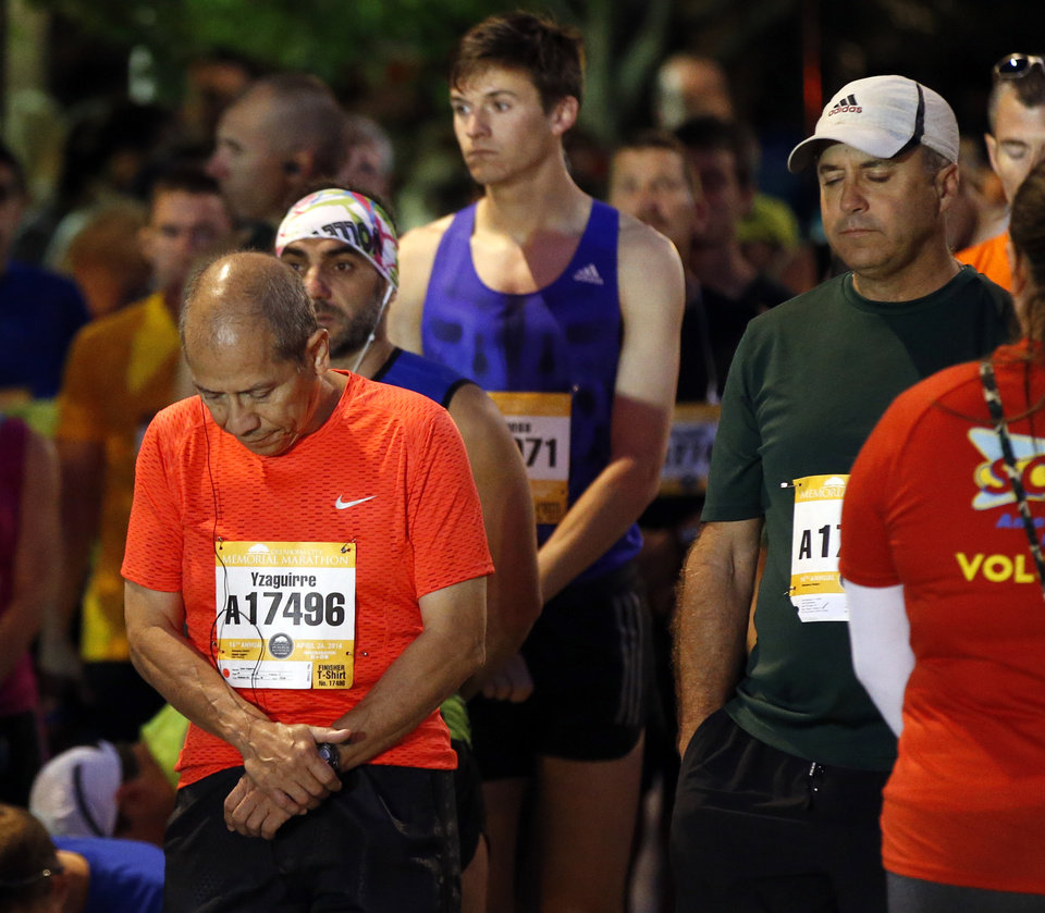 Photo - Runners pause for 168 seconds of silence before the start of the Oklahoma City Memorial Marathon in Oklahoma City, Sunday, April 24, 2016. Photo by Nate Billings, The Oklahoman