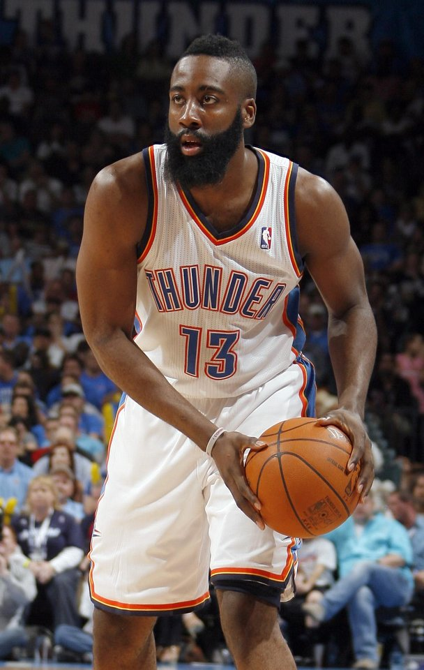 Oklahoma City's James Harden (13) looks to pass the ball during the NBA basketball game between the Chicago Bulls and the Oklahoma City Thunder at Chesapeake Energy Arena in Oklahoma City, Sunday, April 1, 2012. Photo by Sarah Phipps, The Oklahoman