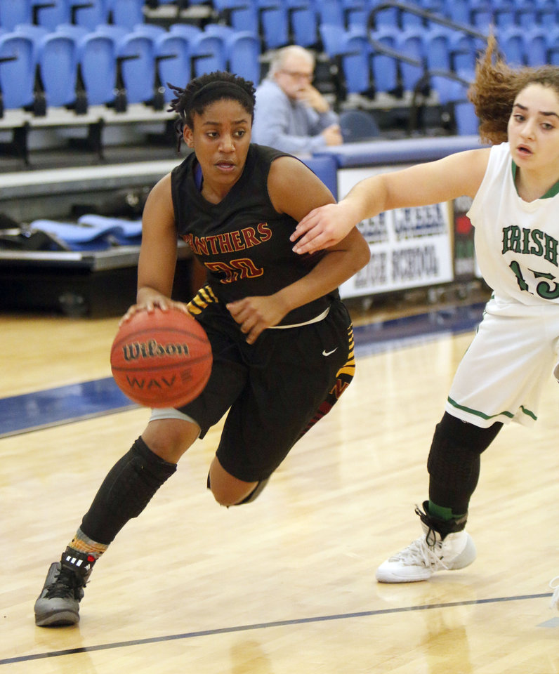 Photo - PC North's Malachi Williams pushes past Bishop McGuinness' Torie Shanbour during the Bishop McGuinness vs. PC North girls game of the Deer Creek, Bruce Gray Invitational basketball game at Deer Creek High School in Oklahoma City, OK, Thursday, January 23, 2014,  Photo by Paul Hellstern, The Oklahoman