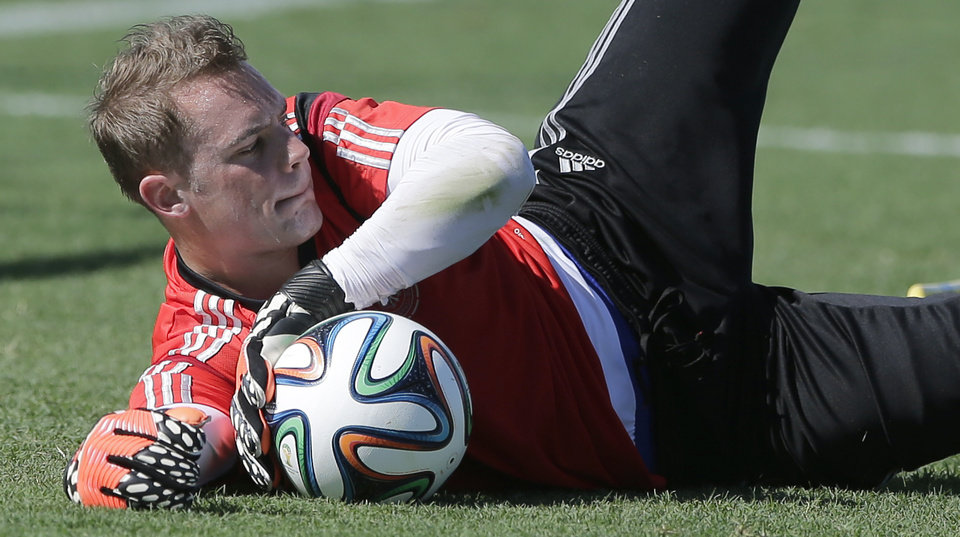 Photo - German national soccer goalkeeper Manuel Neuer catches a ball during a training session in Santo Andre near Porto Seguro, Brazil, Wednesday, June 11, 2014. Germany will play in group G of the 2014 soccer World Cup. (AP Photo/Matthias Schrader)