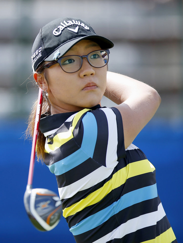 Photo - Lydia Ko, of New Zealand, hits her tee shot at the first hole during the final round of the LPGA Founders Cup golf tournament on Sunday, March 23, 2014, in Phoenix. (AP Photo/Ross D. Franklin)