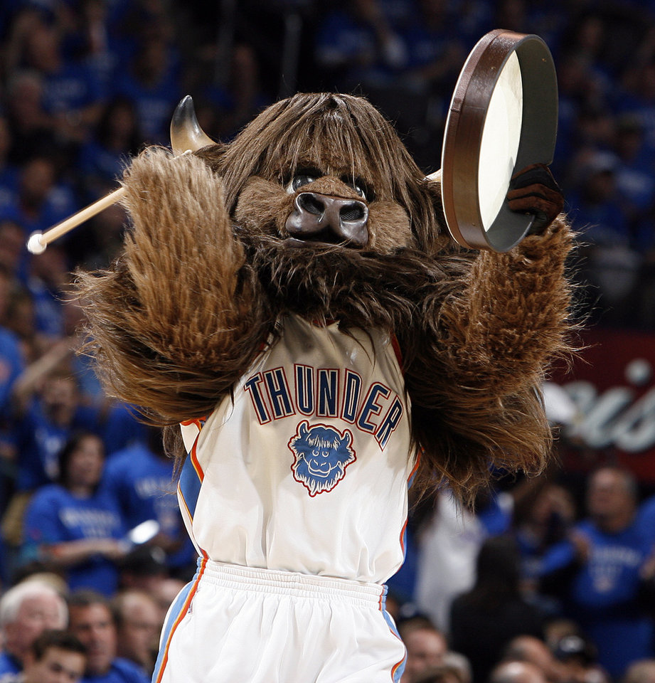 Oklahoma City mascot Rumble the Bison gets the crowd going during game 4 of the Western Conference Finals in the NBA basketball playoffs between the Dallas Mavericks and the Oklahoma City Thunder at the Oklahoma City Arena in downtown Oklahoma City, Monday, May 23, 2011. Photo by Nate Billings, The Oklahoman