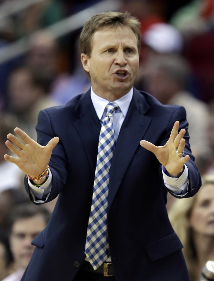 Oklahoma City Thunder head coach Scott Brooks argues an official's call in the first half of an NBA basketball game against the Houston Rockets, Wednesday, Feb. 20, 2013, in Houston. (AP Photo/Pat Sullivan) ORG XMIT: HTR107