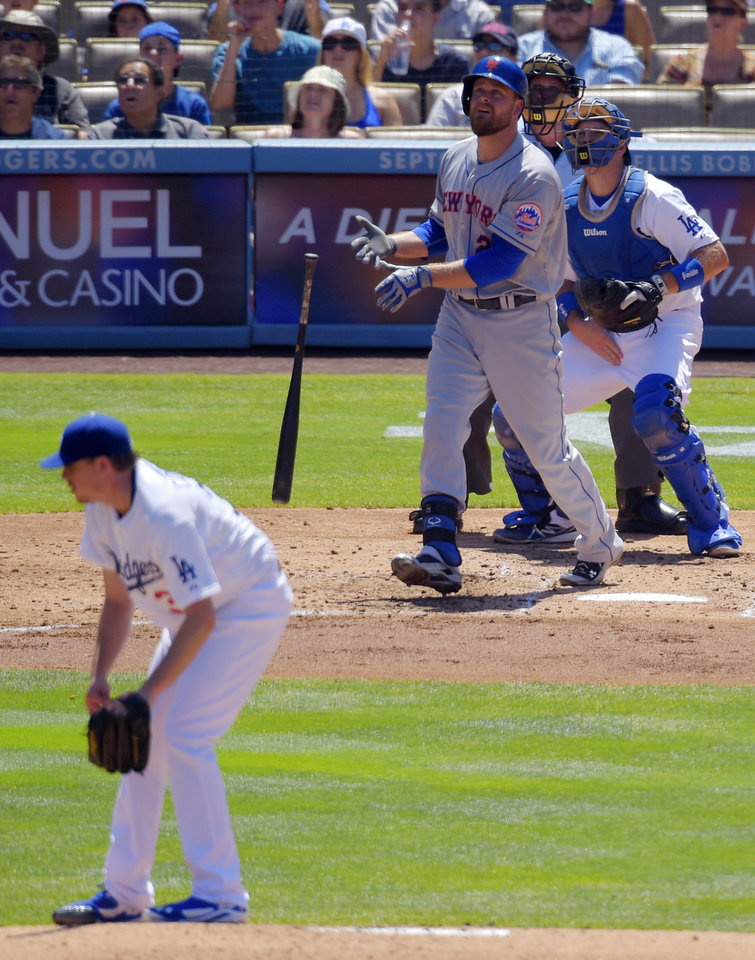 Photo - New York Mets' Lucas Duda, second from left, hits a three-run home run as Los Angeles Dodgers starting pitcher Kevin Correia, left, catcher A.J. Ellis, right, and home plate umpire Dale Scott look on during the third inning of a baseball game, Sunday, Aug. 24, 2014, in Los Angeles. (AP Photo/Mark J. Terrill)