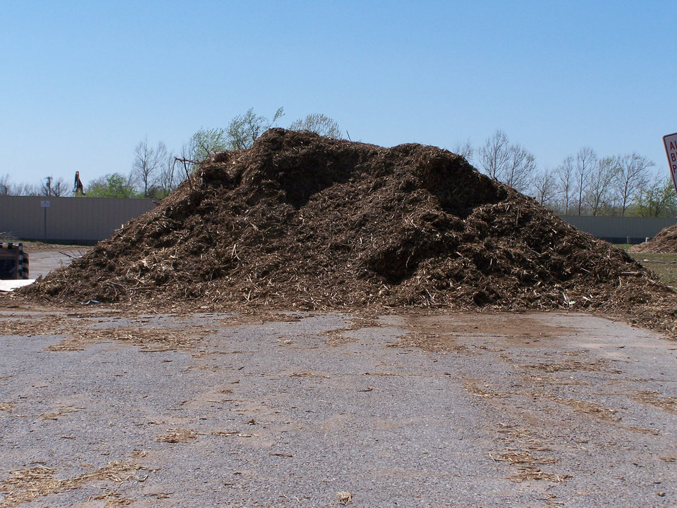 Large mounds of wood chips wait in Warr Acres for citizens or businesses to make use of them.<br/><b>Community Photo By:</b> D. Goodman<br/><b>Submitted By:</b> Darryl, Warr Acres
