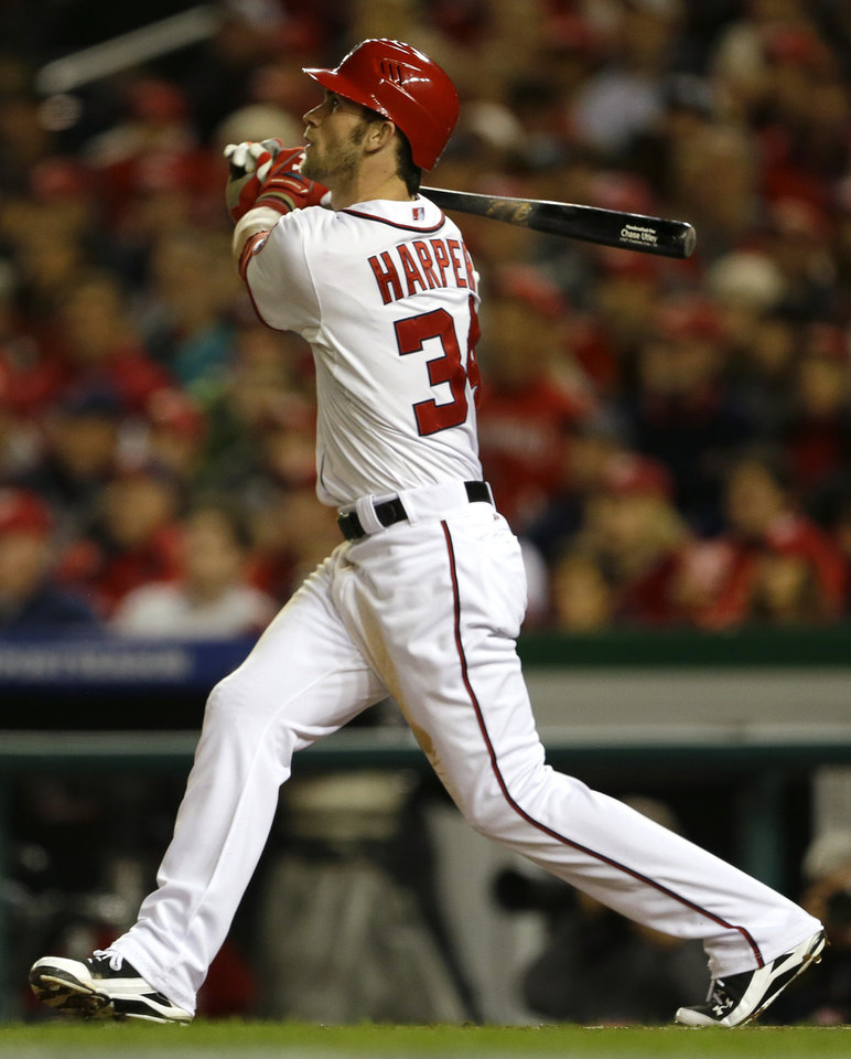 Washington Nationals' Bryce Harper watches his solo home run in the third inning of Game 5 of the National League division baseball series against the St. Louis Cardinals on Friday, Oct. 12, 2012, in Washington. (AP Photo/Pablo Martinez Monsivais)