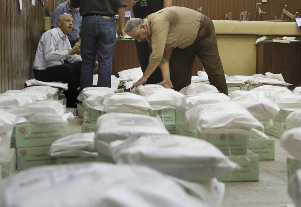Photo - An Egyptian worker arranges boxes of ballots at the Giza courthouse a day before the country's two-day presidential elections begins, in Cairo, Egypt, Sunday, May 25, 2014. Egypt's interim President Adly Mansour has urged Egyptians to come out and vote in this week's presidential election, saying the vote will shape the nation's future. (AP Photo/Amr Nabil)