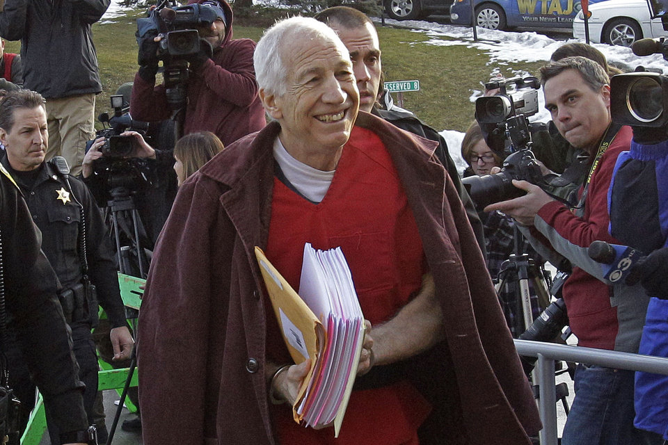 Former Penn State University assistant football coach Jerry Sandusky, center,  arrives at the Centre County Courthouse for a post-sentence motion in Bellefonte, Pa., Thursday, Jan. 10, 2013. (AP Photo/Gene J. Puskar)