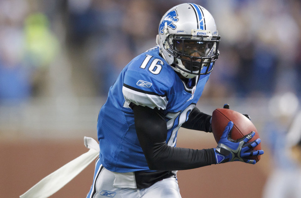 In this Dec. 11, 2011, photo, Detroit Lions wide receiver Titus Young makes a catch for a touchdown during an NFL football game against the Minnesota Vikings in Detroit. The Lions have released Young. The team made the announcement Monday, Feb. 4, 2013. (AP Photo/Rick Osentoski)
