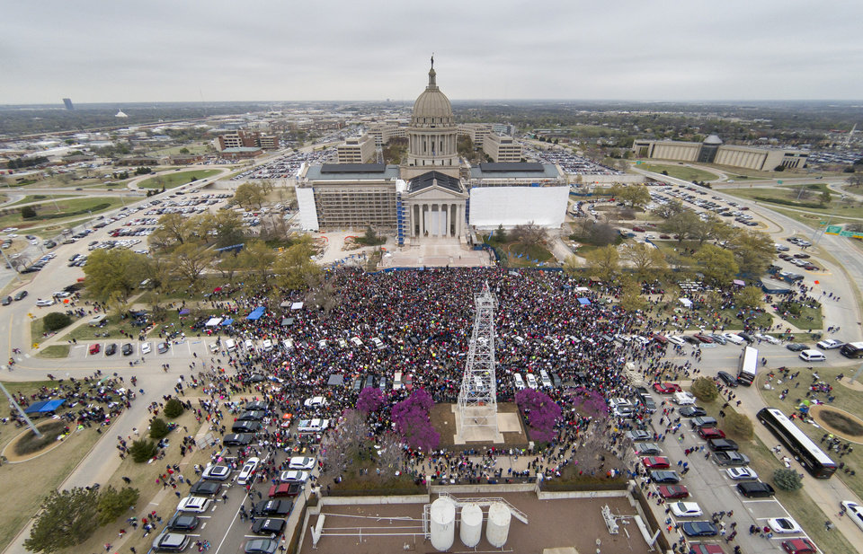 Photo - A large crowd of teachers, students and supporters gather on the south side of the Capitol Monday, April 2, 2018. Photo by Todd Fraser, The Oklahoman