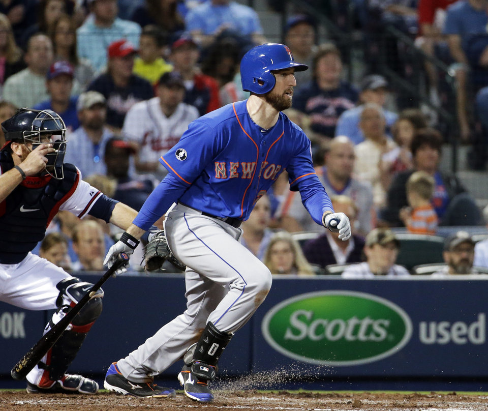 Photo - New York Mets' Ike Davis grounds out to score teammate Daniel Murphy in the third inning of a baseball game against the Atlanta Braves, Thursday, April 10, 2014, in Atlanta. (AP Photo/David Goldman)