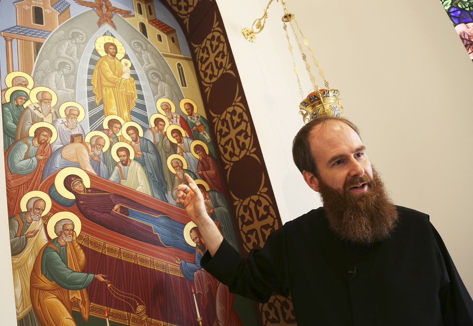Photo - Father Jeremy Davis gives a tour showing off the iconography of his church, St. Elijah Orthodox Christian Church, in Oklahoma City, Wednesday, Oct. 17, 2012.  Photo by Garett Fisbeck, The Oklahoman