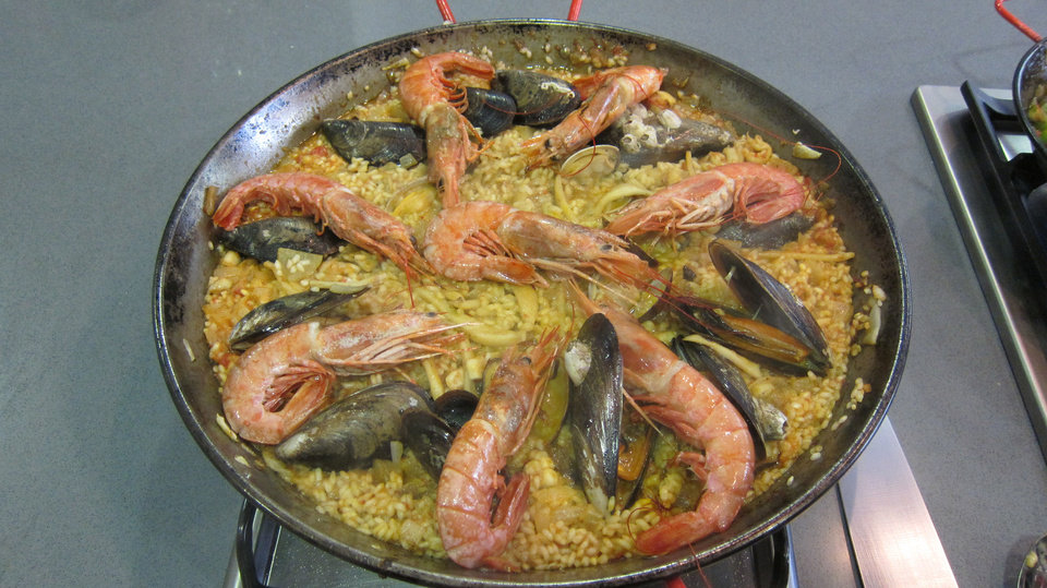 Photo - At Barcelona Cooking, participants learn to make seafood paella. Photo by Wesley K.H. Teo.