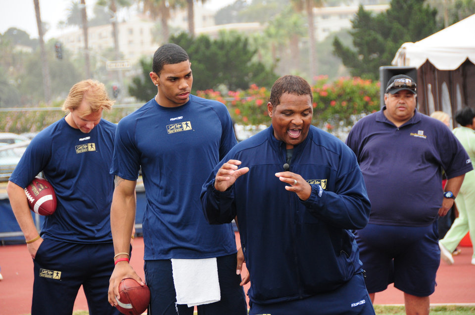 Steve Clarkson, second from right, tutors Ohio State quarterback Terrelle Pryor, second from left. PHOTO BY BRIAN WATSON