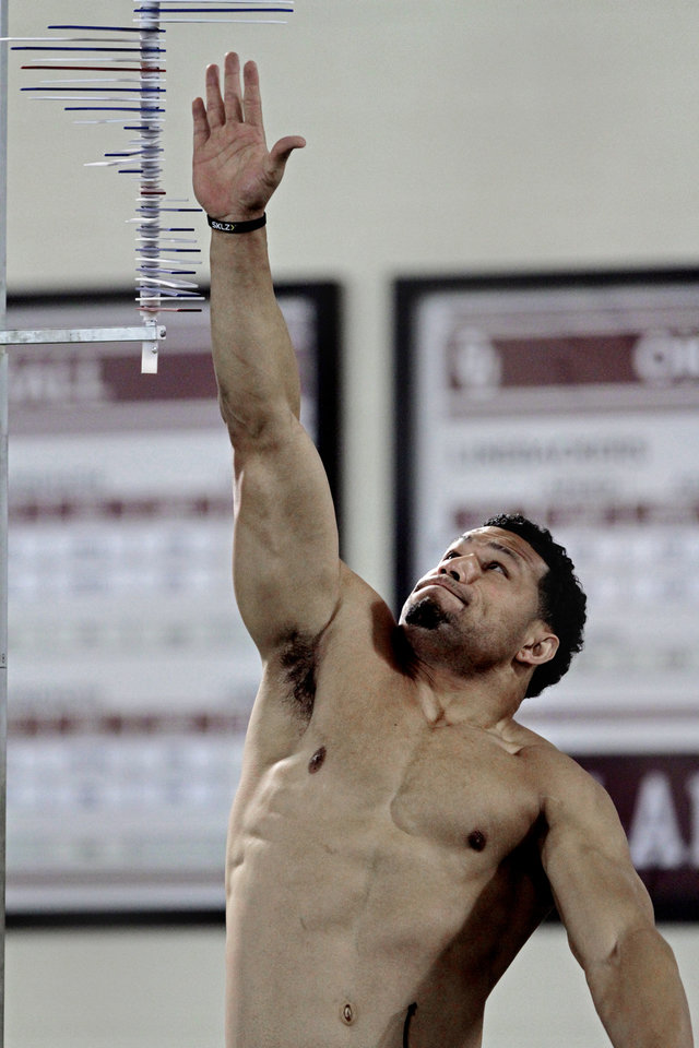 Photo - Travis Lewis shows his vertical leap at the University of Oklahoma (OU)'s football team's annual Pro Day workouts on Wednesday, March 14, 2012, in Norman, Okla.  Photo by Steve Sisney, The Oklahoman