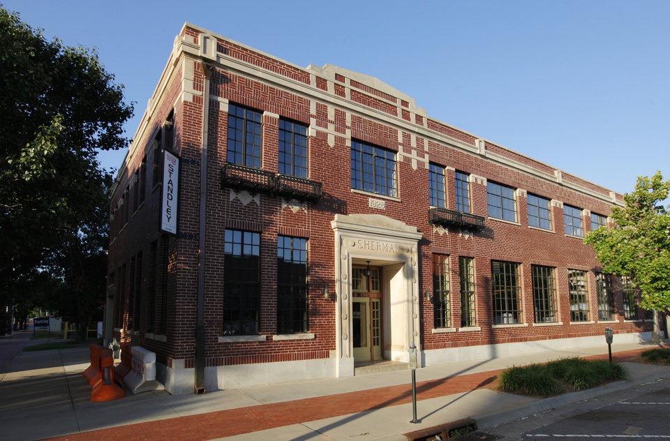 Photo -  Standley Systems LLC received a Certificate of Merit for rehabilitation of the Sherman Iron Works building, 26 E Main St. from the State Historic Preservation Office of the Oklahoma Historical Society. PHOTO BY PAUL B. SOUTHERLAND   PAUL B. SOUTHERLAND