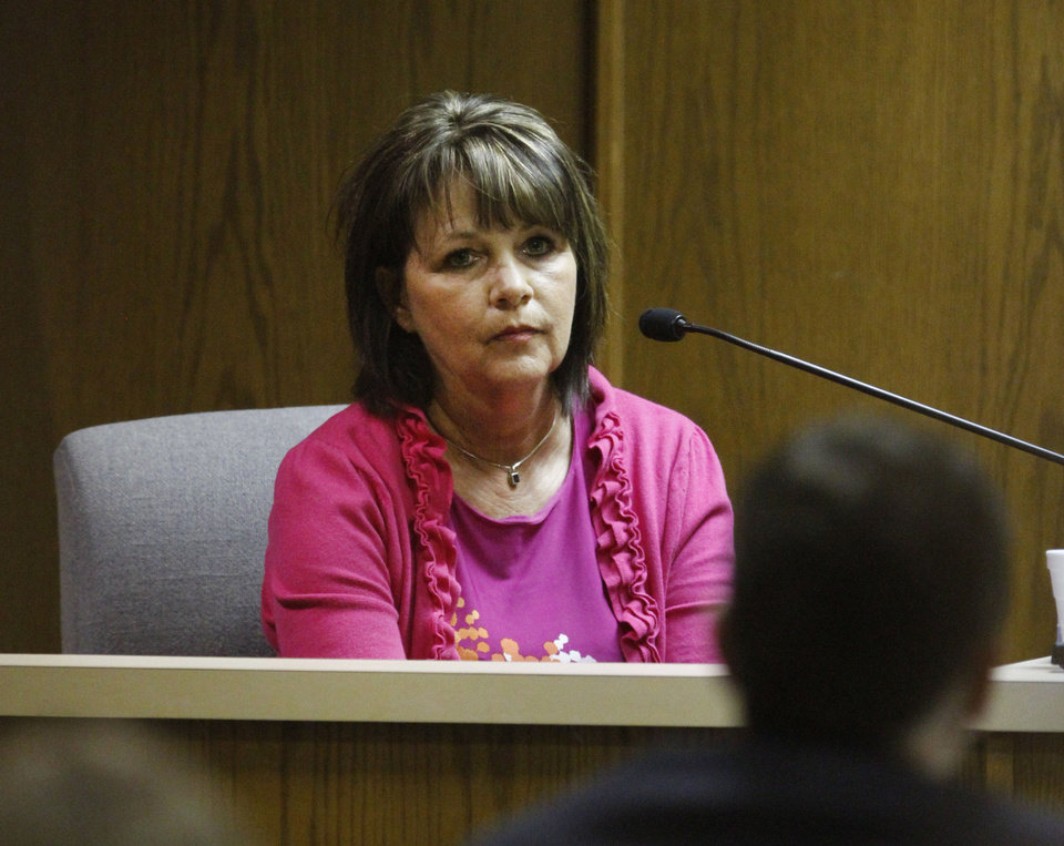 Photo - Debbie Proctor appears on the witness stand Wednesday May 8, 2013, during Rebecca Bryan's murder trial in the Canadian County Courthouse in El Reno. Bryan is accused of killing her husband, Keith Bryan, 52, who was the Nichols Hills fire Chief. Photo By Steve Gooch, The Oklahoman  Steve Gooch - The Oklahoman