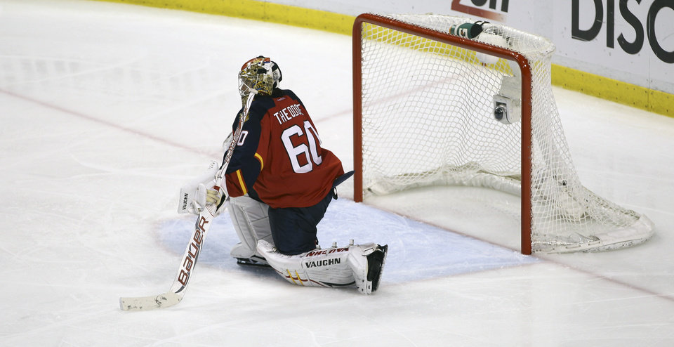 Photo -   Florida Panthers goalie Jose Theodore sits on the ice after the second overtime period of Game 7 in a first-round NHL Stanley Cup playoff hockey series in Sunrise, Fla., Thursday, April 26, 2012, against the New Jersey Devils. The Devils won 3-2. (AP Photo/J Pat Carter)