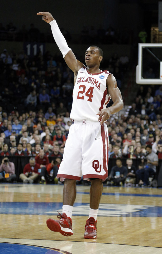 Photo - Oklahoma's Buddy Hield (24) celebrates a three-point basket during the NCAA men's basketball tournament game between the University of Oklahoma and North Dakota State at the Spokane Arena in Spokane, Wash., Thursday, March 20, 2014. Photo by Sarah Phipps, The Oklahoman