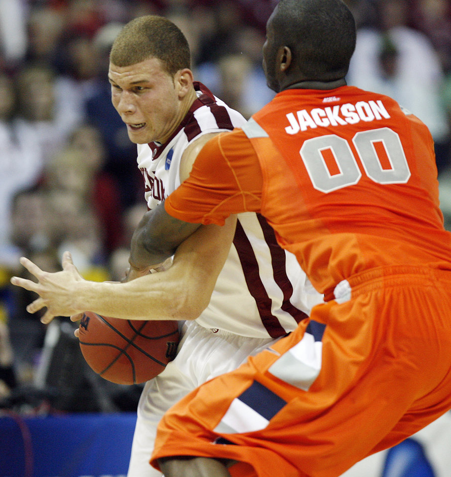Syracuse's Rick Jackson (00) fouls Oklahoma's Blake Griffin (23) during the first half of the NCAA Men's Basketball Regional at the FedEx Forum on Friday, March 27, 2009, in Memphis, Tenn.PHOTO BY CHRIS LANDSBERGER, THE OKLAHOMAN