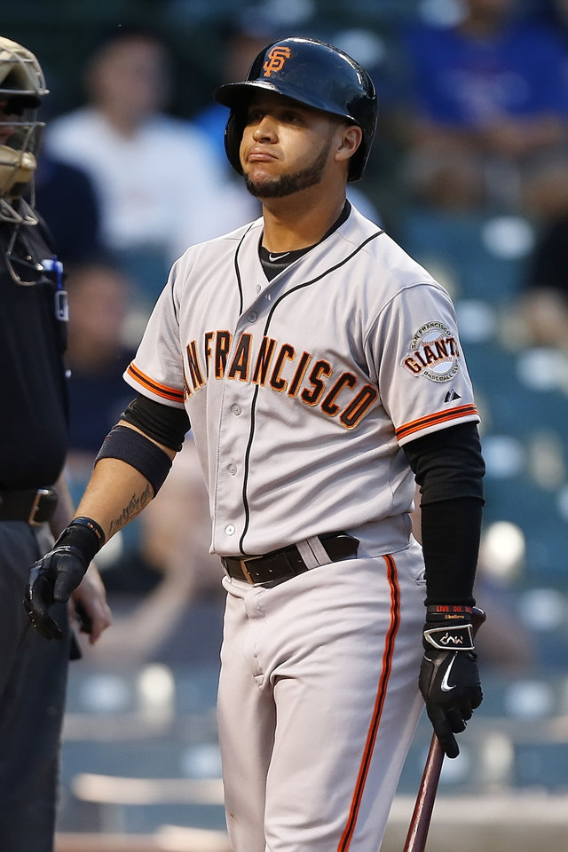 Photo - San Francisco Giants' Gregor Blanco reacts after striking out against the Chicago Cubs during the ninth inning of thecontinuationof arain-suspended baseballgame that beganTuesday, on Thursday, Aug. 21, 2014, in Chicago. The Chicago Cubs won 2-1.(AP Photo/Andrew A. Nelles)