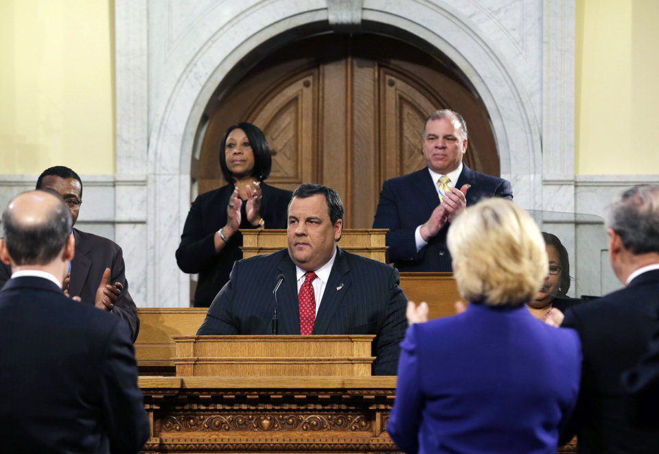 Photo - New Jersey Gov. Chris Christie, center, receives a standing ovation from Senate President Stephen M. Sweeney, center right, D-Thorofare, and Assembly Speaker Sheila Y. Oliver, center left, D-East Orange, as he delivers his State Of The State address at the Statehouse, Tuesday, Jan. 8, 2013, in Trenton, N.J. Christie promised in his annual State of the State address Tuesday that New Jersey will be back