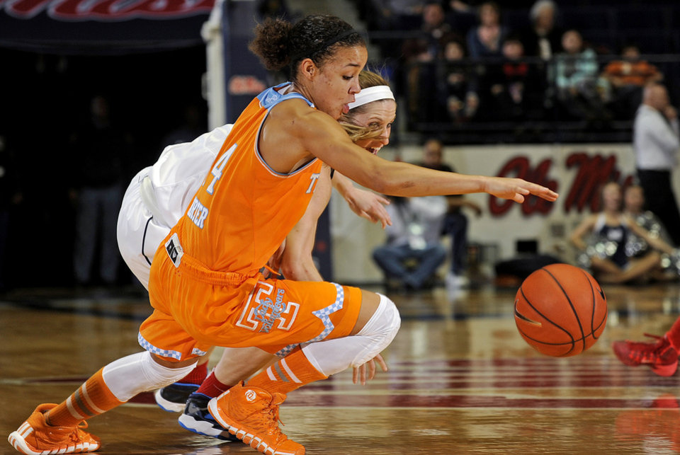 Photo - Tennessee guard Andraya Carter (14) and Mississippi guard Gracie Frizzell dive for the ball during the first half of an NCAA college basketball game in Oxford, Miss., Thursday, Feb. 6, 2014. (AP Photo/Thomas Graning)
