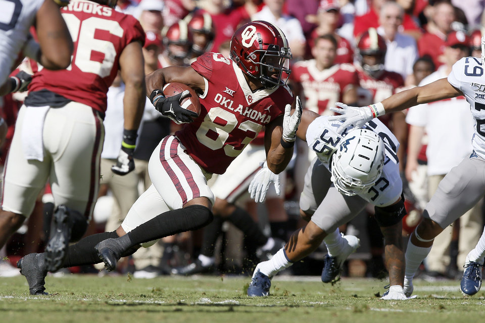 Photo - Oklahoma's Nick Basquine (83) runs after a reception during a college football game between the University of Oklahoma Sooners (OU) and the West Virginia Mountaineers at Gaylord Family-Oklahoma Memorial Stadium in Norman, Okla, Saturday, Oct. 19, 2019. Oklahoma won 52-14. [Bryan Terry/The Oklahoman]
