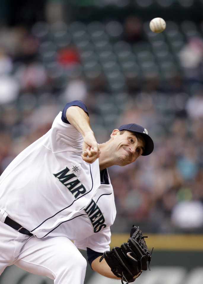Photo - Seattle Mariners starting pitcher Chris Young throws against the Kansas City Royals in the third inning of a baseball game Saturday, May 10, 2014, in Seattle. (AP Photo/Elaine Thompson)