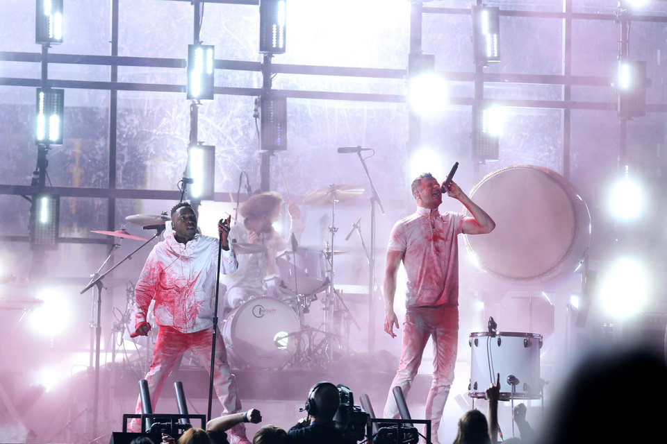 Photo - Kendrick Lamar, left, and Dan Reynolds of Imagine Dragons perform at the 56th annual Grammy Awards at Staples Center on Sunday, Jan. 26, 2014, in Los Angeles. (Photo by Matt Sayles/Invision/AP)