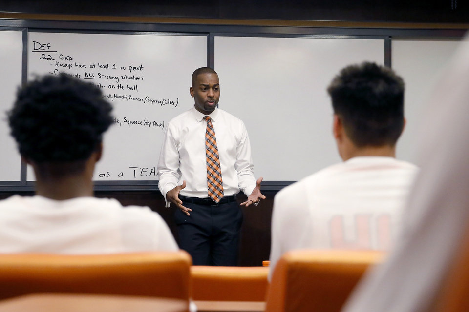 Photo - Oklahoma State coach Mike Boynton talks with his team before a 78-50 defeat against Texas Tech on Wednesday at Gallagher-Iba Arena in Stillwater. [Bryan Terry/The Oklahoman]