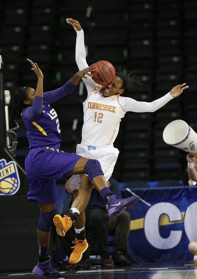 Photo - LSU forward Shanece McKinney (21) blocks a shot by Tennessee forward Bashaara Graves during the first half in an NCAA college basketball game in the quarterfinals of the Southeastern Conference women's tournament, Friday, March 7, 2014, in Duluth, Ga.(AP Photo/John Bazemore)