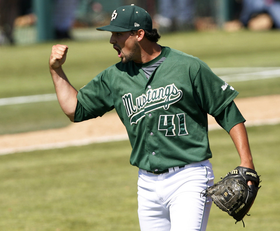 Photo - Cal Poly closing pitcher Reed Reilly celebrates after the final out against Sacramento State in an NCAA college baseball tournament regional game on Sunday, June 1, 2014, at Baggett Stadium at Cal Poly in San Luis Obispo, Calif. Cal Poly won 6-5. (AP Photo/Aaron Lambert)
