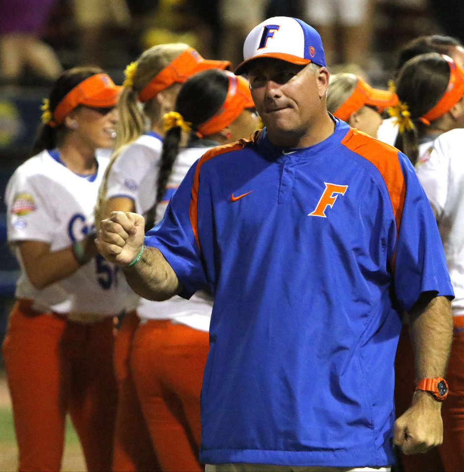 Photo -  Florida's Coach Tim Walton celebrates a win behind his team during Game 1 in the championship series of the Women's College World Series between Florida and Michigan at ASA Hall of Fame Stadium in Oklahoma City on Monday June 1, 2015. Photo by Jackie Dobson, The Oklahoman.