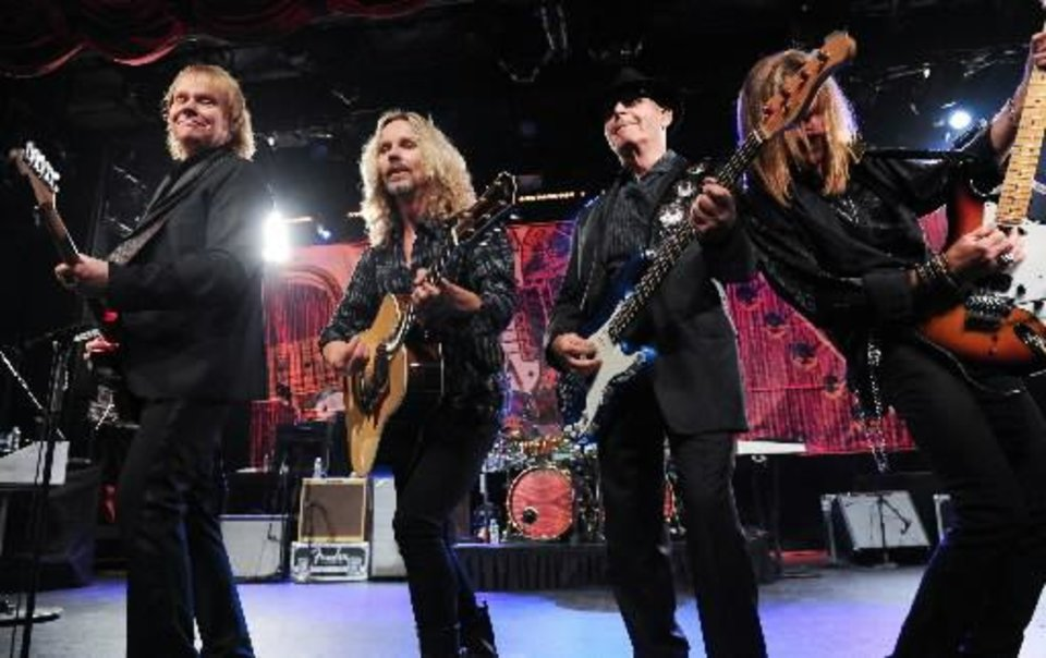 "From left, musicians James ""J.Y."" Young, Tommy Shaw, Chuck Panozzo and Ricky Phillips of the band Styx, perform at Eric Clapton\'s Crossroads Guitar Festival artist party at The Hard Rock Cafe New York on Thursday, April 11, 2013 in New York City, New York. (AP)"