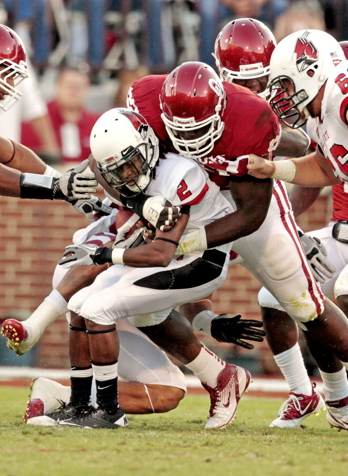 Photo - Oklahoma Sooners' Stacy McGee (92) stops Ball State Cardinals' Jamill Smith (2) during the first half of the college football game between the University of Oklahoma Sooners (OU) and the Ball State Cardinals at Gaylord Family-Oklahoma Memorial Stadium on Saturday, Oct. 1, 2011, in Norman, Okla. Photo by Steve Sisney, The Oklahoman