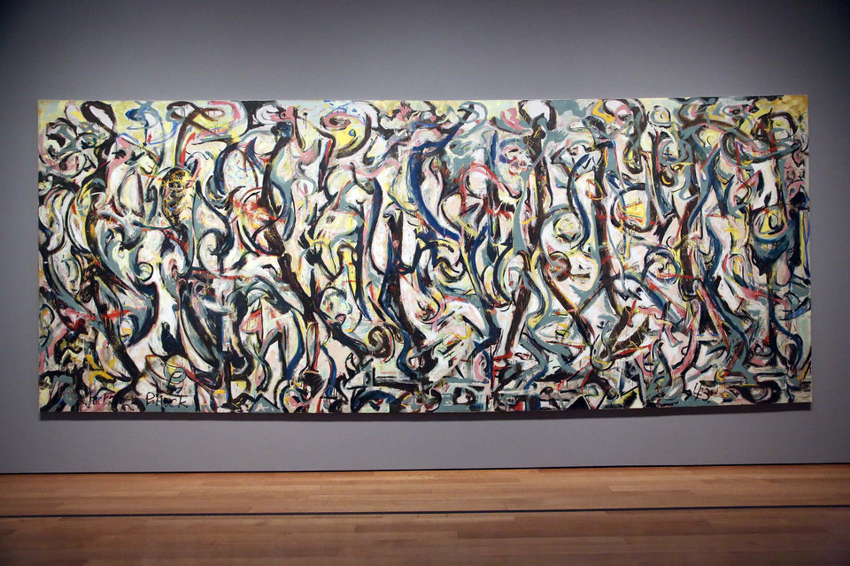 """Photo - Jackson Pollock's """"Mural,"""" 1943, as installed at the J. Paul Getty Museum in Los Angeles on Monday, March 10, 2014. The oil-on-canvas work, measuring more than 8 feet high and nearly 20 feet long, has been under wraps at the J. Paul Getty Museum for more than a year undergoing extensive restoration. The painting, owned by the University of Iowa, will be on display at The J. Paul Getty Museum for three months, from March 11 to June 1, 2014 at the Getty Center. (AP Photo/Nick Ut )"""