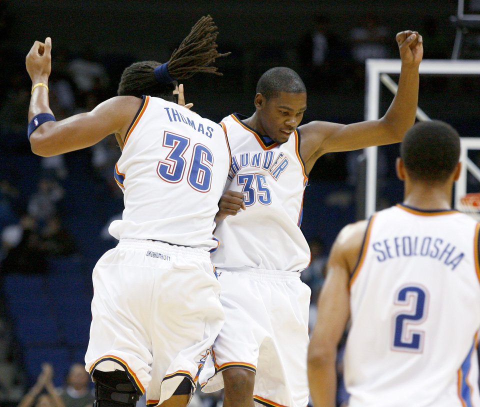 Oklahoma City's Kevin Durant, right, and Etan Thomas celebrate during an NBA preseason game between the Oklahoma City Thunder and the Miami Heat at the BOK Center in Tulsa, Okla., Wednesday, October 14, 2009. Photo by Bryan Terry, The Oklahoman